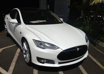 White Tesla with paint protection film on hood
