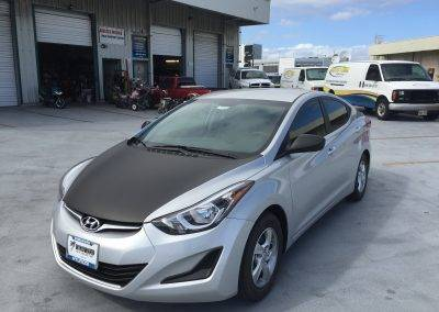 black color change wrap to hood of Hyundai Accent